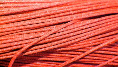 redish: Orange yarn closeup textile background Stock Photo