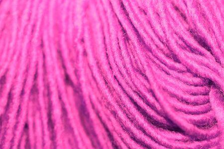 fuchsia: Fuchsia wool yarn closeup background striped texture Stock Photo
