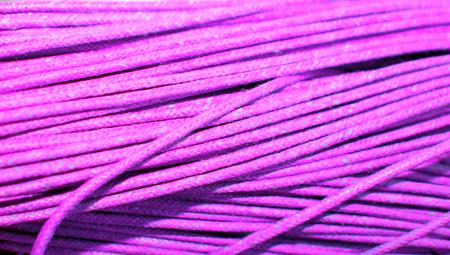 pinkish: Pinkish purple cord textile background closeup