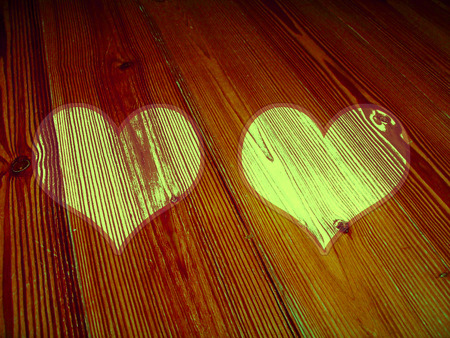romaticism: Hearts couple on vintage striped wood background