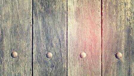 verticals: Wood wall background close up with nails