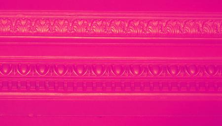redish: Pink elegant molding ornament background close up