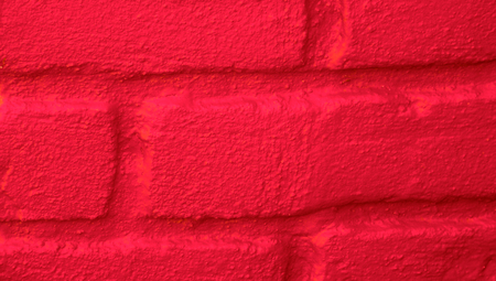 redish: Wall blocks red paint close up abstract background Stock Photo