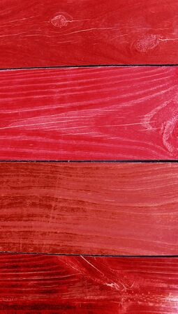 redish: Red painted wood stripes background close up