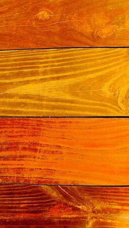 painted wood: Orange painted pine wood background close up