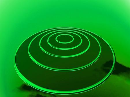 Circular OVNI under green light background