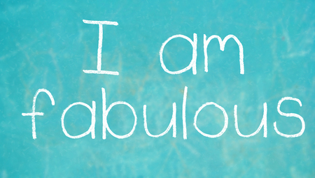 i am: I am fabulous words of chalk on class background