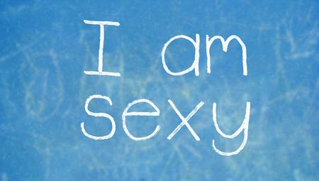 i am: I am sexy word of chalk on blue chalkboard