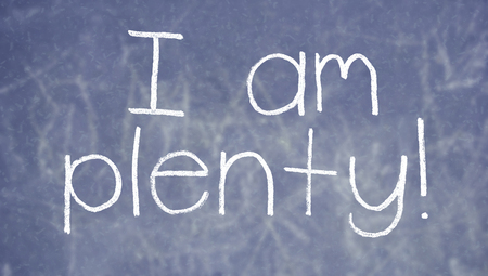 plenty: I am plenty concept on school blackboard