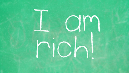 i am: I am rich on green background of school Stock Photo