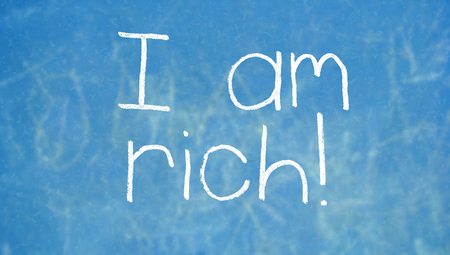 i am: I am rich words written by hand with chalk on class