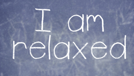 i am: I am relaxed written with chalk by hand