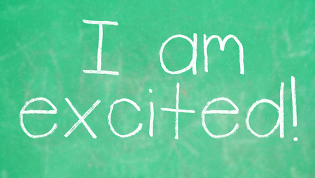 i am: I am excited about school written on green chalkboard Stock Photo
