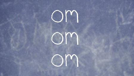 repetition: Om mantra repetition on chalkboard Stock Photo