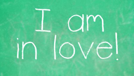 i am: I am in love chalk wortd on green background