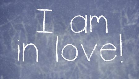 i am: I am in love written on chalkboard