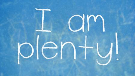 i am: I am plenty words on blue chalkboard
