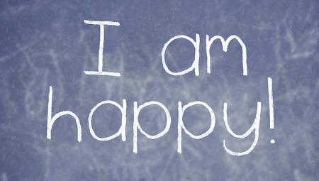 i am: I am happy chalk words on blackboard background