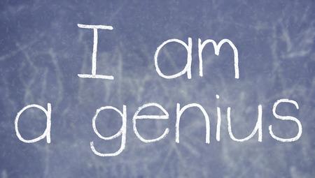 i am: I am a genius sentence written with chalk on blackboard background Stock Photo