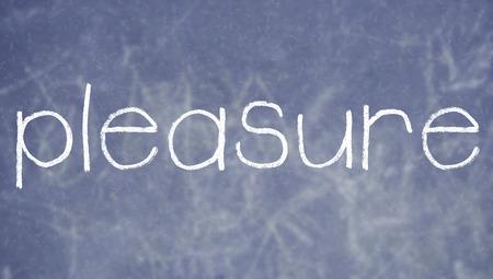 Pleasure chalk word on blackboard background Banco de Imagens