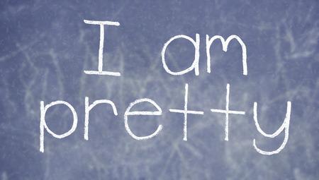 i am: I am pretty sentence on english class blackboard Stock Photo