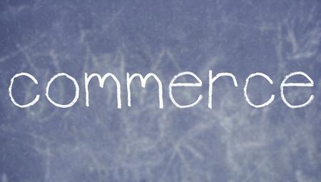 commerce: Commerce handwritten word on economy class blackboard Stock Photo