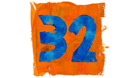 32: Number 32 painted with blue on orange Stock Photo