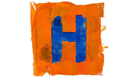 Letter H of blue paint on orange
