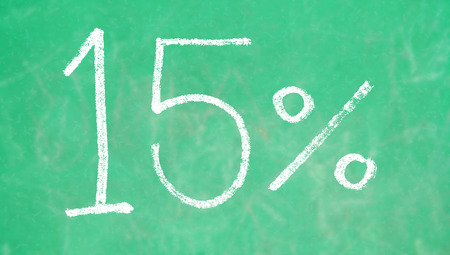 15: 15 percent chalk signs on green blackboard background Stock Photo