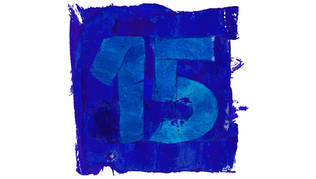 number 15: Number 15 of blue paint in a square of paintbrushes Stock Photo