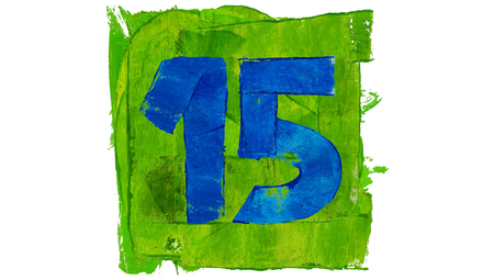 number 15: Number 15 painted with blue on green square of paint Stock Photo