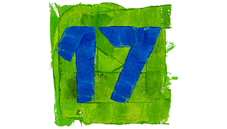 17: Number 17 painted with blue on green square of paint