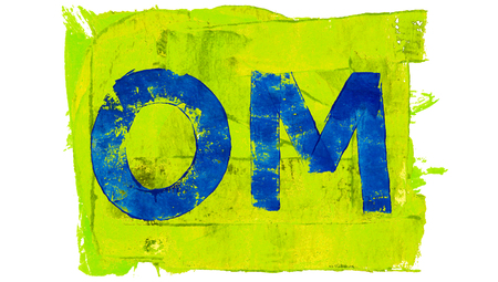mantra: Om blue painted mantra on greenish yellow square of paint