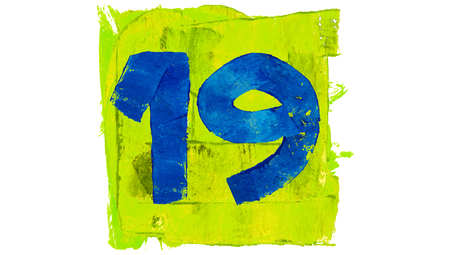 19: Number 19 painted with vibrant paint colours Stock Photo
