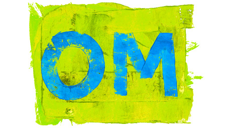 yellowish green: Blue om letters of paint on yellowish green Stock Photo