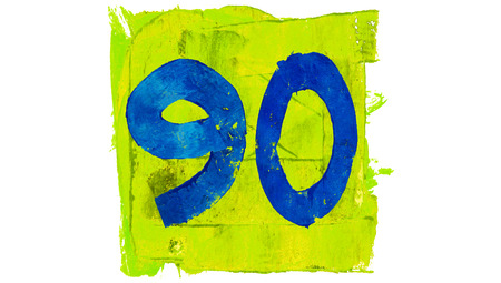 yellowish: Number 90 painted with blue on yellowish green square Stock Photo