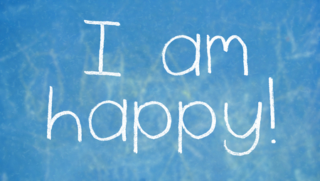 i am: I am happy chalk words on blue Stock Photo