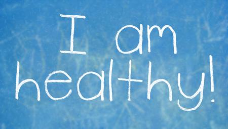 i am: I am healthy word of chalk on blue