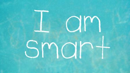 i am: I am smart chalk words on blue blackboard
