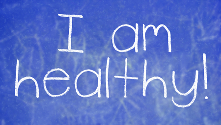 i am: I am healthy handwritten with chalk on blue Stock Photo
