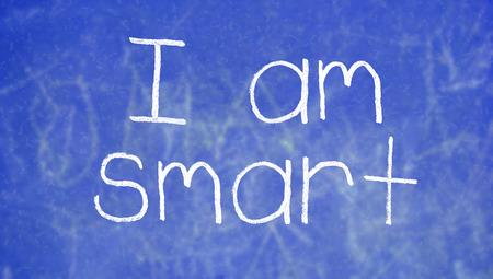 i am: I am smart sentence handwritten with chalk on blue class chalkboard