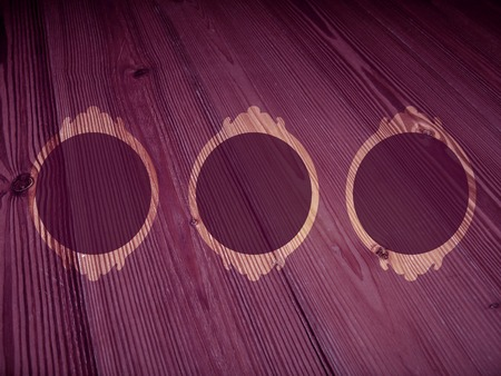 misterious: Vintage three circular frames on wood purple backdrop Stock Photo