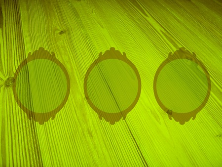 misterious: Light green wood circular frames background