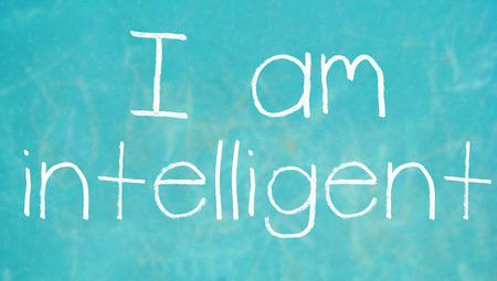 i am: I am intelligent chalk words written on blue chalkboard