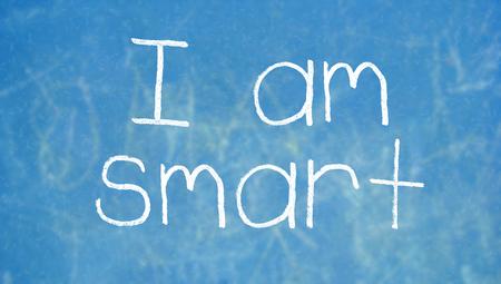 i am: I am smart written on blue chalk board