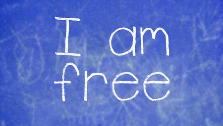 i am: I am free sentence on blue chalk board of a class