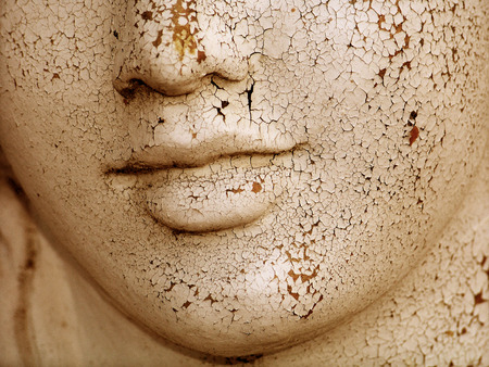 Dried skin cracked woman sculptural face close up
