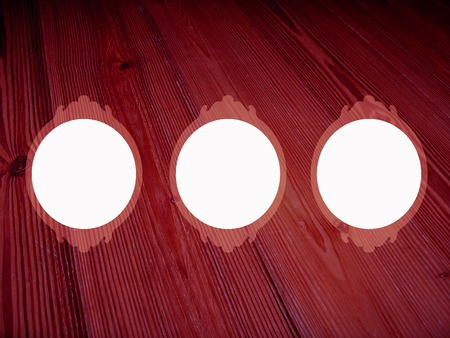 pics: Dark red wood background with three circular frames for pics