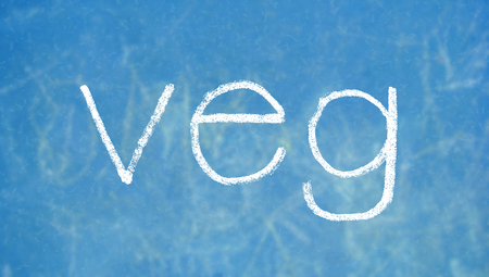 veg: Veg letters of chalk on blue board