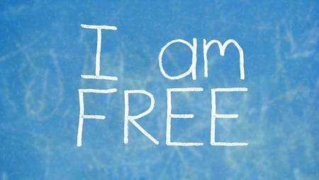 i am: I am free written with chalk